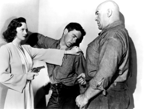 Behind Locked Doors (1948) Directed by Budd Boetticher Shown from left: Lucille Bremer, Richard Carlson, Tor Johnson